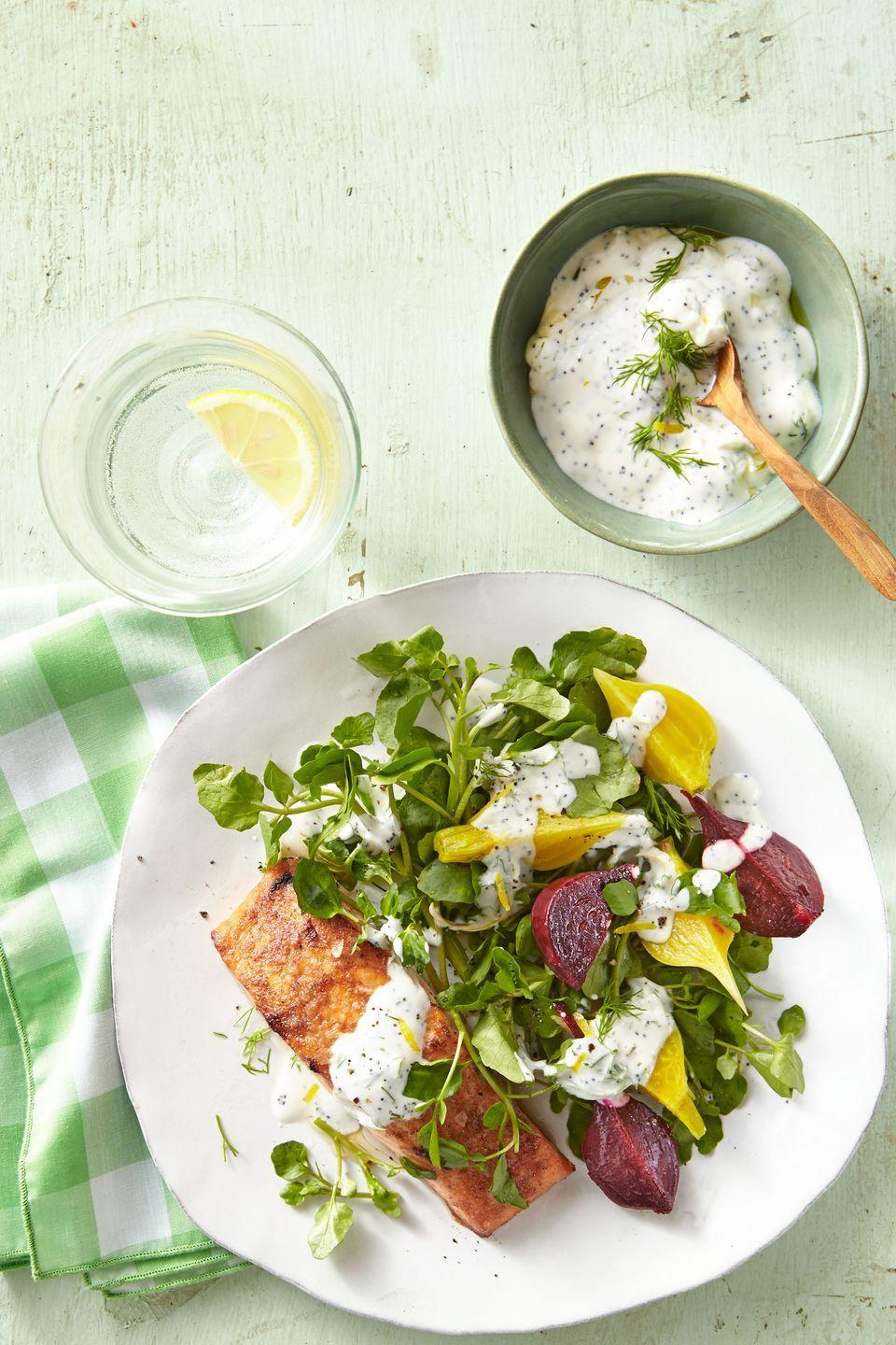 "<p>You can't <em>beet</em> this dish. (Sorry, we couldn't resist.)</p><p><strong><a href=""https://www.countryliving.com/food-drinks/recipes/a37756/salmon-and-beets-with-yogurt-sauce-over-watercress-recipe/"" rel=""nofollow noopener"" target=""_blank"" data-ylk=""slk:Get the recipe"" class=""link rapid-noclick-resp"">Get the recipe</a>.</strong></p>"