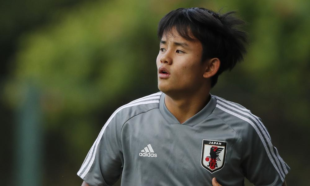 """<img alt=""""Japan's Takefusa Kubo is one of the hottest properties in world football."""" width=""""1000"""" height=""""600""""/><span>Japan's Takefusa Kubo is one of the hottest properties in world football.</span> <span>Photograph: Nelson Antoine/AP</span>  <p>Takefusa Kubo joined Barcelona when he was 10, spent four years at the club and was singled out as a future star but that future now belongs to their greatest rivals after Real Madrid announced the signing of the Japan international.</p> <p>Just 18, Kubo was forced to leave Barça in 2015 after the club was investigated for breaking Fifa regulations on signing young players, returning to Japan and joining FC Tokyo's youth system. Barcelona had hoped to bring the attacking midfielder back when he came of age but instead it is Madrid who have agreed a €2m deal with Tokyo and handed Kubo a six-year contract believed to be worth €1m a season. He will initially join the club's B team, Castilla, but the plan is he will be incorporated into the first team in his second season.</p> <p>Barcelona were unwilling to match the demands made by the player, who had also attracted interest from Paris Saint-Germain, and have sought to play down the damage but his decision to join Real Madrid was inevitably greeted by many as a defeat at the hands of their competitors. Although Madrid have not signed him from Barcelona, he was expected to end up at the Camp Nou, where he began.</p> <p>The frustration is greater because of the manner in which Barcelona lost control of Kubo, who is now a senior international and in the Japan squad that has been invited to play at the Copa América. Kubo was one of a dozen players mentioned in the initial investigation over Barcelona breaking article 19 of Fifa's regulations on international transfers, designed to protect under-18s. Barcelona protested against the verdict and lobbied for a change of policy but there have been no alterations and those protests did not prevent their punishment.</p> <p>Josep Maria Bar"""