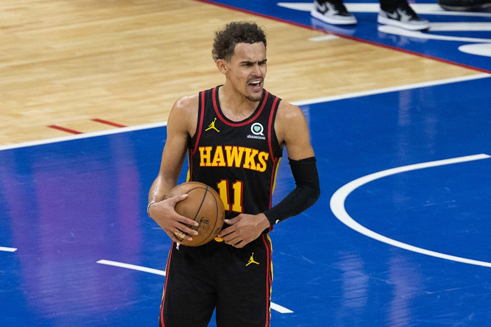 Trae Young reacts and celebrates in the closing seconds of Game 7.