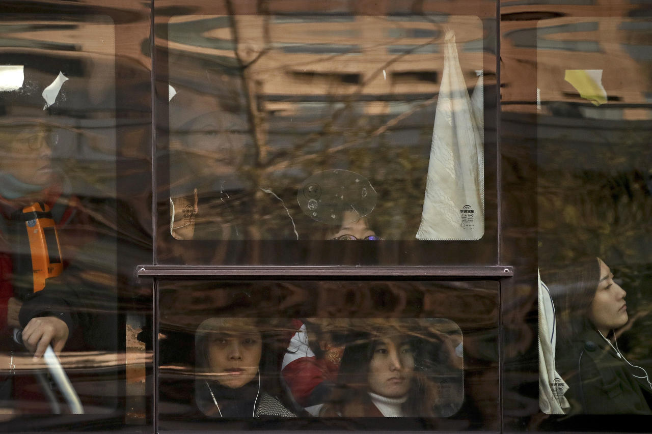 <p> In this Nov. 28, 2017, photo, Chinese women look out of a window of a crowded bus traveling from the outskirts of the capital city during the morning rush hour, in Beijing. Human Rights Watch released the report on Monday, April 23, 2018, gender discrimination is widespread in the Chinese work force, with many hiring advertisements openly calling only for male applicants and using the attractiveness of female co-workers as a draw. (AP Photo/Andy Wong) </p>