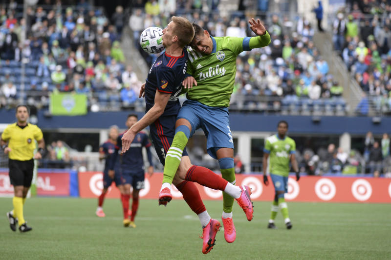 SEATTLE, WA - MARCH 01: Chicago Fire Robert Beric (27) and Zavier Arreaga (3) go up for a header during a MLS match between the Chicago Fire and the Seattle Sounders at Century Link Field in Seattle, WA. (Photo by Jeff Halstead/Icon Sportswire via Getty Images)