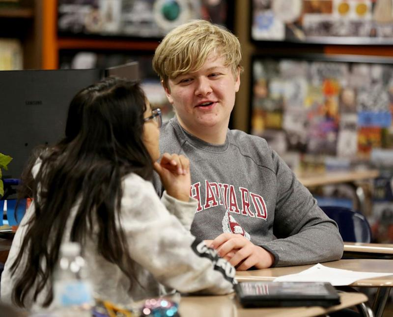Braxton Moral, right, and a high school classmate | Sandra J. Milburn/The Hutchinson News via AP