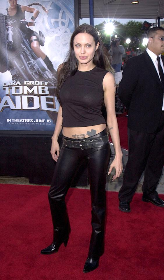 """7. <a href=""""http://movies.yahoo.com/movie/1804770389/info"""">Lara Croft: Tomb Raider</a> LA premiere (2001)   It was, by no means, her best look, but one of Angelina's most memorable red carpet statements was made when she sported this painfully casual ensemble, consisting of a belly-baring tank and low-rise leather pants, to the """"Tomb Raider"""" premiere in '01."""