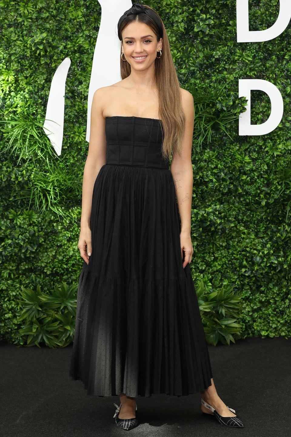 """<p>Who: Jessica Alba </p><p>When: June 15, 2019</p><p>Wearing: Dior</p><p>Why: You don't have to wear heels with a gown, as proven by Jessica Alba. Worn to the Monte-Carlo, Monaco photocall of <em>L.A.'s Finest, </em>she styled her dress down with easy flats and an on-trend <a href=""""https://www.elle.com/beauty/hair/a28121759/padded-headbands-trend/"""" rel=""""nofollow noopener"""" target=""""_blank"""" data-ylk=""""slk:headband"""" class=""""link rapid-noclick-resp"""">headband</a>. </p>"""