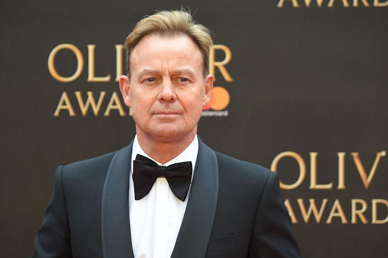Australian actor Jason Donovan poses on the red carpet upon arrival to attend The Olivier Awards at the Royal Albert Hall in central London on April 8, 2018. / AFP PHOTO / Anthony HARVEY (Photo credit should read ANTHONY HARVEY/AFP/Getty Images)