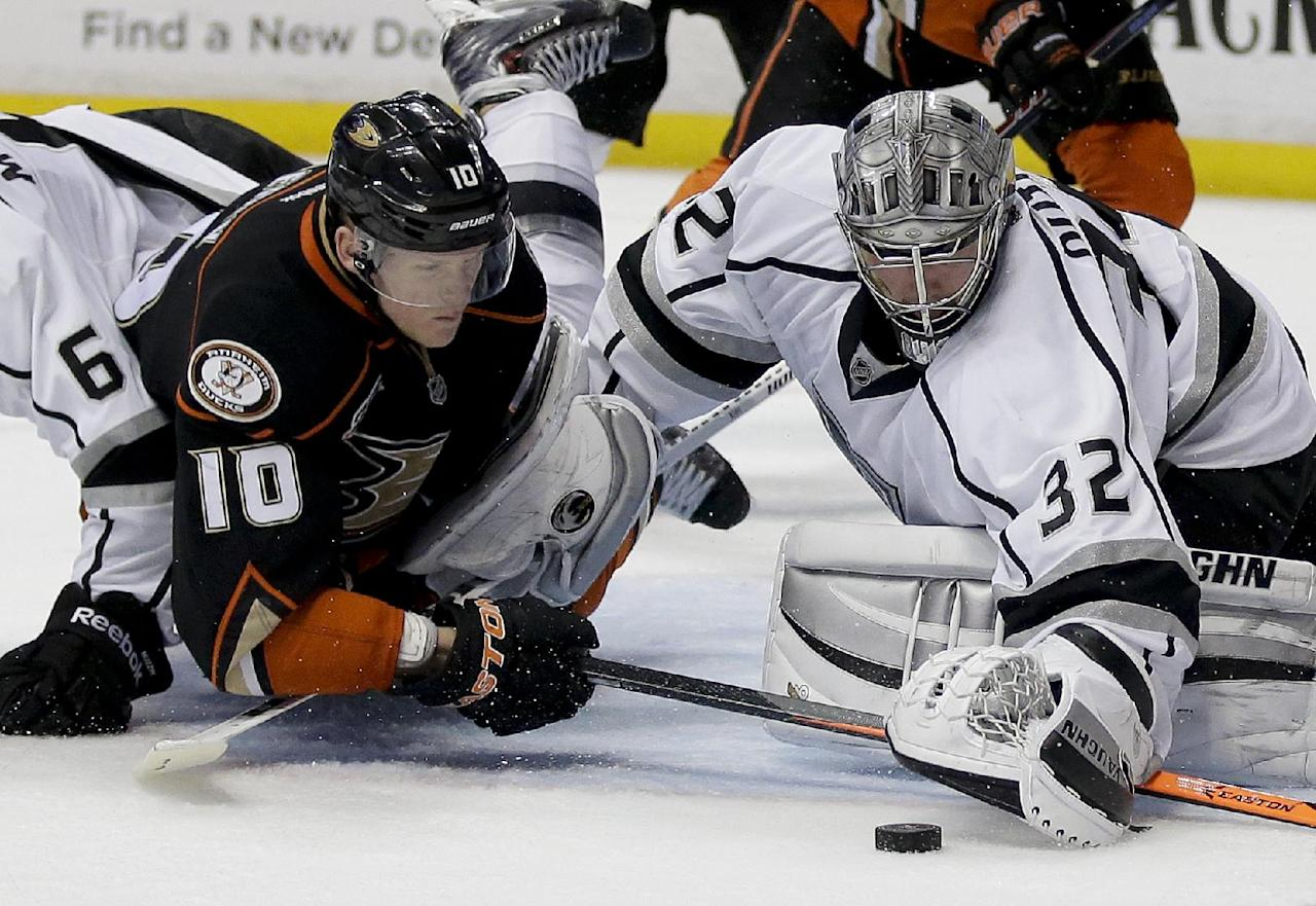 Los Angeles Kings goalie Jonathan Quick, right, blocks a shot by Anaheim Ducks right wing Corey Perry during the second period in Game 7 of an NHL hockey second-round Stanley Cup playoff series in Anaheim, Calif., Friday, May 16, 2014. (AP Photo/Chris Carlson)