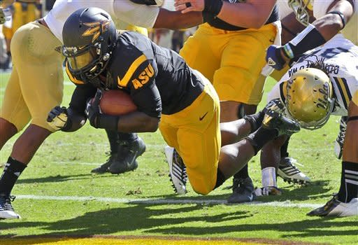 Arizona State running back Marion Grice scores a touchdown against UCLA during the first half of an NCAA college football game, Saturday, Oct. 27, 2012, in Tempe, Ariz. (AP Photo/Matt York)