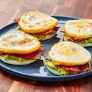 """<p>Using the egg for the bun on this classic <a href=""""https://www.delish.com/uk/cooking/recipes/g30312476/low-carb-breakfast-recipes/"""" rel=""""nofollow noopener"""" target=""""_blank"""" data-ylk=""""slk:breakfast"""" class=""""link rapid-noclick-resp"""">breakfast</a> sandwich is a true genius move. We loaded ours up with bacon, cheddar, and avocado but go for some of your favourite fillings! Sausage and gruyère would be killer too! </p><p>Get the <a href=""""https://www.delish.com/uk/cooking/recipes/a30805681/bunless-bacon-egg-and-cheese-recipe/"""" rel=""""nofollow noopener"""" target=""""_blank"""" data-ylk=""""slk:Bunless Bacon, Egg & Cheese"""" class=""""link rapid-noclick-resp"""">Bunless Bacon, Egg & Cheese</a> recipe.</p>"""