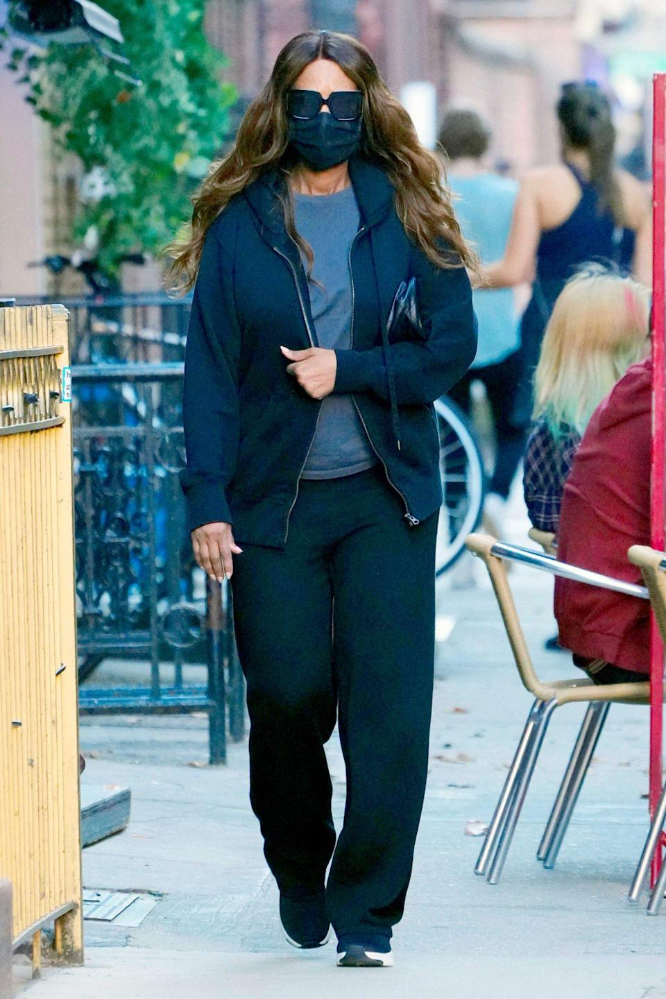 <p>Iman goes incognito in sunglasses and a face mask while out for a walk on Sunday in N.Y.C. </p>