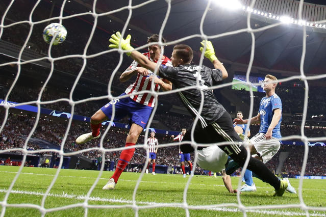 Atletico Madrid's Stefan Savic scores his side's first goal during the Champions League Group D soccer match between Atletico Madrid and Juventus at Wanda Metropolitano stadium in Madrid, Spain, Wednesday, Sept. 18, 2019. (AP Photo/Manu Fernandez)