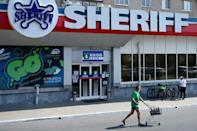 Sheriff -- the word is on everyone's lips be it on the way to the football -- or the supermarket (AFP/Sergei GAPON)