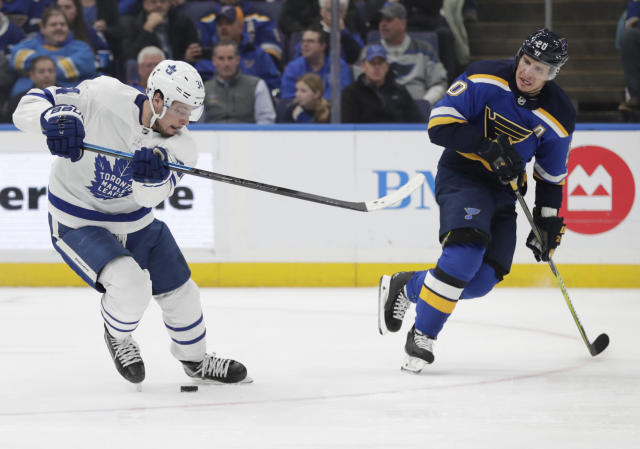 Toronto Maple Leafs' Auston Matthews (34) controls the puck in front of St. Louis Blues' Alexander Steen (20) during the second period of an NHL hockey game Tuesday, Feb. 19, 2019, in St. Louis. (AP Photo/Tom Gannam)