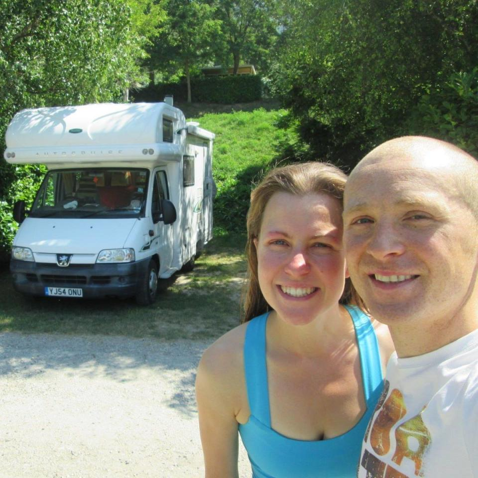 Esther Dingley and Dan Colegate smile together in front of their camper van.