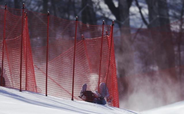 <p>Russia's PavelTrikhichev lies after crashing during the downhill portion of the men's combined at the 2018 Winter Olympics in Jeongseon, South Korea, Tuesday, Feb. 13, 2018. (AP Photo/Luca Bruno) </p>