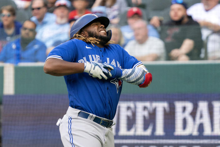 Toronto Blue Jays' Vladimir Guerrero Jr. reacts after being hit in the hand by a pitch during the sixth inning of a baseball game against the Texas Rangers Monday, April 5, 2021, in Arlington, Texas. (AP Photo/Jeffrey McWhorter)