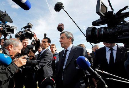 Francois Fillon (R), former French prime minister, member of the Republicans political party and 2017 presidential election candidate of the French centre-right walks in vineyards, surrounded by the media, after a meeting with winegrowers in Nimes, France, March 2, 2017. REUTERS/Jean-Paul Pelissier