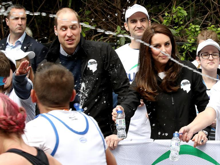 Prince William and Duchess of Cambridge splashed with water by London Marathon runner