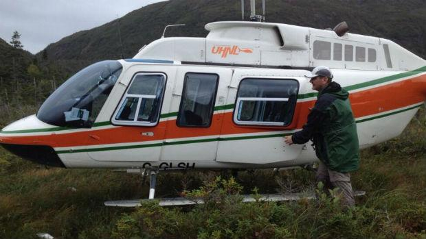 Stranded balloonist Jonathan Trappe boards a helicopter chartered by CBC after being stranded south of Lark Harbour on Thursday.