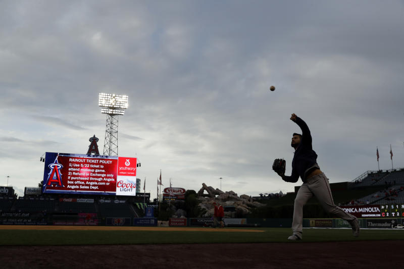 Minnesota Twins starting pitcher Martin Perez throws near the dugout before the start of the team's scheduled baseball game against the Los Angeles Angels Wednesday, May 22, 2019, in Anaheim, Calif. The game was postponed. (AP Photo/Marcio Jose Sanchez)