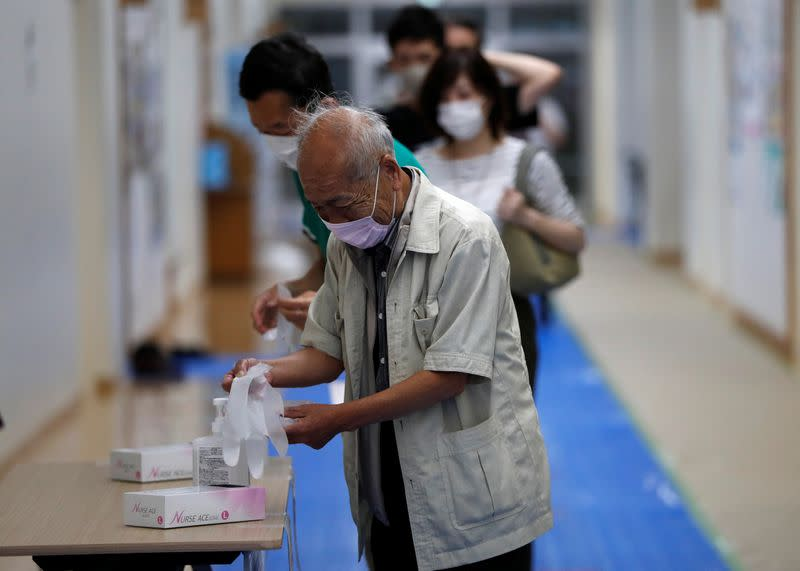 Tokyo governor re-elected after plaudits for COVID-19 response - exit poll