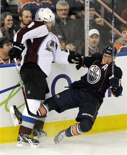 Colorado Avalanche's Jan Hejda checks Edmonton Oilers' Ales Hemsky, right, during the first period of an NHL hockey game, Tuesday, Jan. 31, 2012, in Edmonton, Alberta. (AP Photo/The Canadian Press, John Ulan)