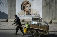 Murals and billboards of Massoud are slowly being defaced, painted over or removed following the Taliban takeover of Kabul (AFP/Aamir QURESHI)