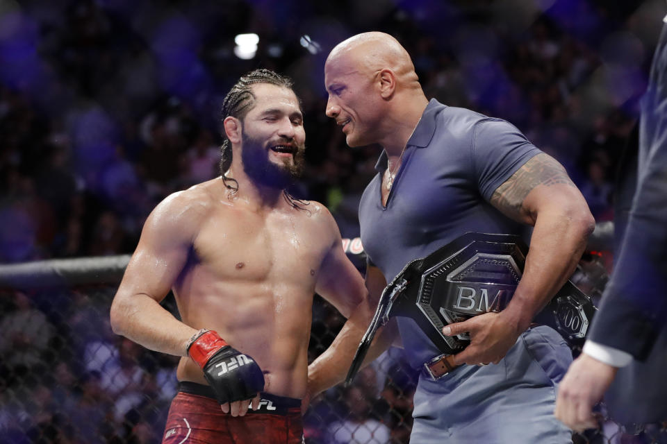 """Jorge Masvidal, left, talks to Dwayne """"The Rock"""" Johnson after a welterweight mixed martial arts bout against Nate Diaz at UFC 244 early Sunday, Nov. 3, 2019, in New York. Masvidal won in the fourth round.(AP Photo/Frank Franklin II)"""