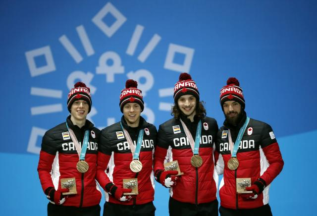 Medals Ceremony - Short Track Speed Skating Events - Pyeongchang 2018 Winter Olympics - Men's 5000m Relay - Medals Plaza - Pyeongchang, South Korea - February 23, 2018 - Bronze medalists Samuel Girard, Charles Hamelin, Charle Cournoyer and Pascal Dion of Canada on the podium. REUTERS/Kim Hong-Ji
