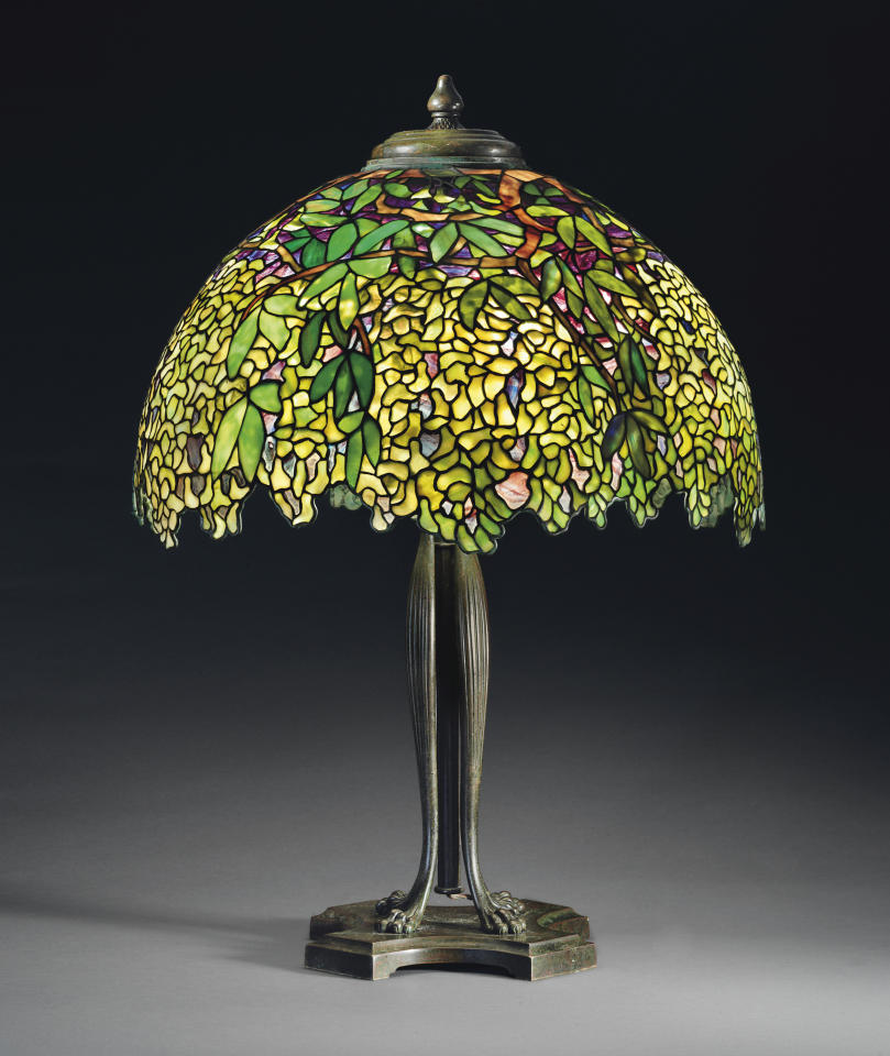 "This undated photo provided by Christie's shows Tiffany's circa 1910 ""Laburnum"" leaded glass and bronze table lamp. The lamp, which graced San Francisco's popular Eddie Rickenbacker bar, is being sold on June 14, by Christie's auction house in New York. Eddie Rickenbacker's colorful proprietor, Norman Jay Hobday, died in February 2011. Hobday's Tiffany collection of six lamps and one chandelier is expected to bring more than $2 million. (AP Photo/Christie's)"