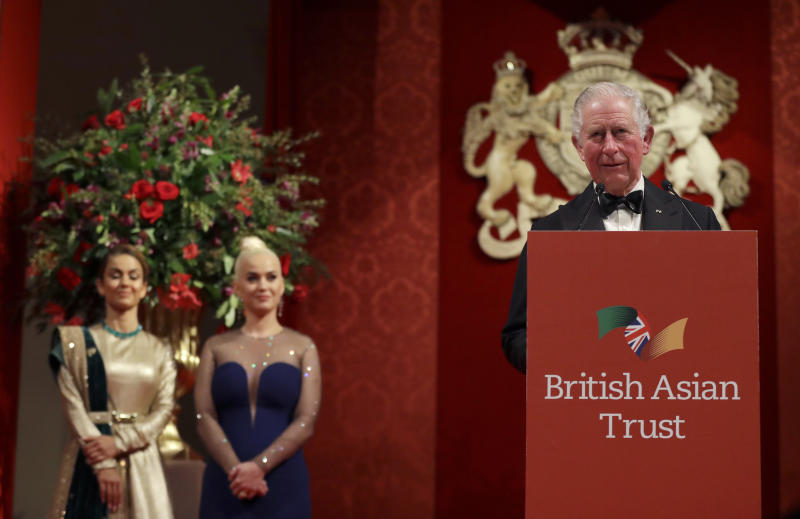 Katy Perry, center, and Natasha Poonawalla, listen as Britain's Charles, Royal Founding Patron of the British Asian Trust, gives a speech as he attends a reception for supporters of the British Asian Trust in London, Tuesday, Feb. 4, 2020. (AP Photo/Kirsty Wigglesworth, pool)