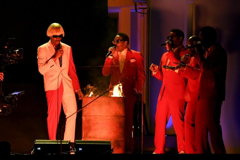US rapper Tyler, The Creator (L) launched into his Grammys performance with R&B legend Charlie Wilson (C) and group Boyz II Men at his side