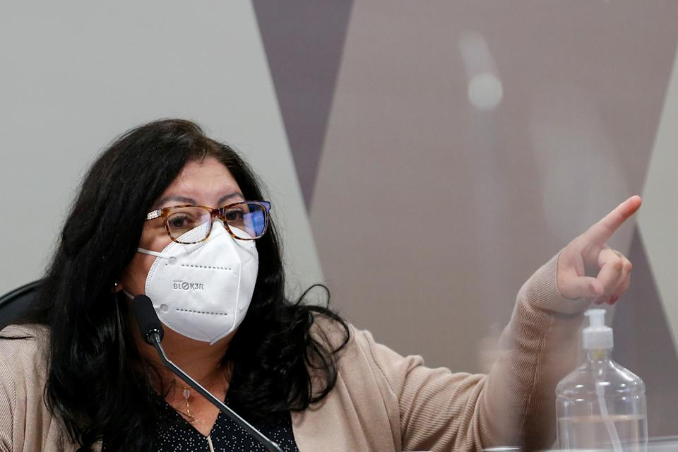 Employee of the Ministry of Health, Regina Celia Silva Oliveira gestures during a meeting of the Parliamentary Inquiry Committee (CPI) to investigate government actions and management during the coronavirus disease (COVID-19) pandemic, at the Federal Senate in Brasilia, Brazil July 6, 2021. REUTERS/Adriano Machado