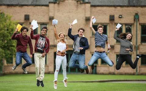 <span>Students celebrate A-Level results - but the cost of university is making some youngsters consider apprenticeships</span> <span>Credit: SWNS </span>