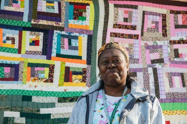 Doris Pettway Mosely, a quilter in Gee's Bend, with one of her creations.