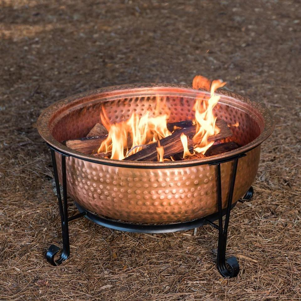 """<p><strong>Fire Sense</strong></p><p>homedepot.com</p><p><strong>$217.60</strong></p><p><a href=""""https://go.redirectingat.com?id=74968X1596630&url=https%3A%2F%2Fwww.homedepot.com%2Fp%2FFire-Sense-Palermo-26-in-x-21-in-Round-Hammered-Wood-Burning-Fire-Pit-in-Copper-with-Fire-Tool-62665%2F306554331&sref=https%3A%2F%2Fwww.housebeautiful.com%2Fshopping%2Fhome-accessories%2Fg32129002%2Fbest-fire-pit%2F"""" rel=""""nofollow noopener"""" target=""""_blank"""" data-ylk=""""slk:BUY NOW"""" class=""""link rapid-noclick-resp"""">BUY NOW</a></p><p>This copper fire pit is a stunning wood-burning option that's on the smaller side. Measuring 26 inches in diameter, it comes with the stand seen here, as well as a spark screen, fire tool, and weather cover.</p>"""