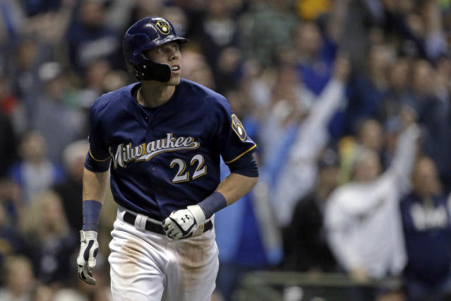 Milwaukee Brewers' Christian Yelich watches his three-run home run during the fifth inning of the team's baseball game against the St. Louis Cardinals on Tuesday, April 16, 2019, in Milwaukee. (AP Photo/Aaron Gash)