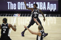 Los Angeles Clippers guard Patrick Beverley reacts after making 3-point basket during the second half against the Utah Jazz in an NBA basketball game in Los Angeles, Friday, Feb. 19, 2021. (AP Photo/Kelvin Kuo)