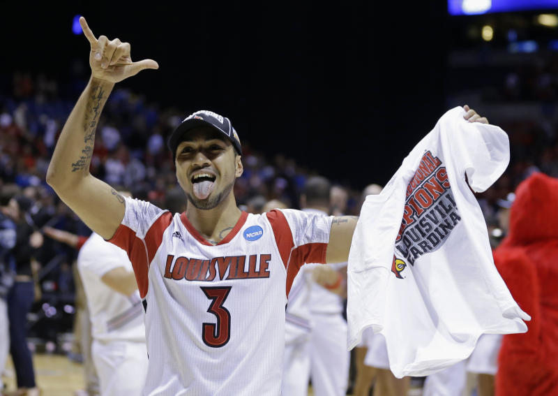Louisville guard Peyton Siva celebrates after Louisville's 85-63 win over Duke in Midwest Regional final in the NCAA college basketball tournament, Sunday, March 31, 2013, in Indianapolis. (AP Photo/Darron Cummings)