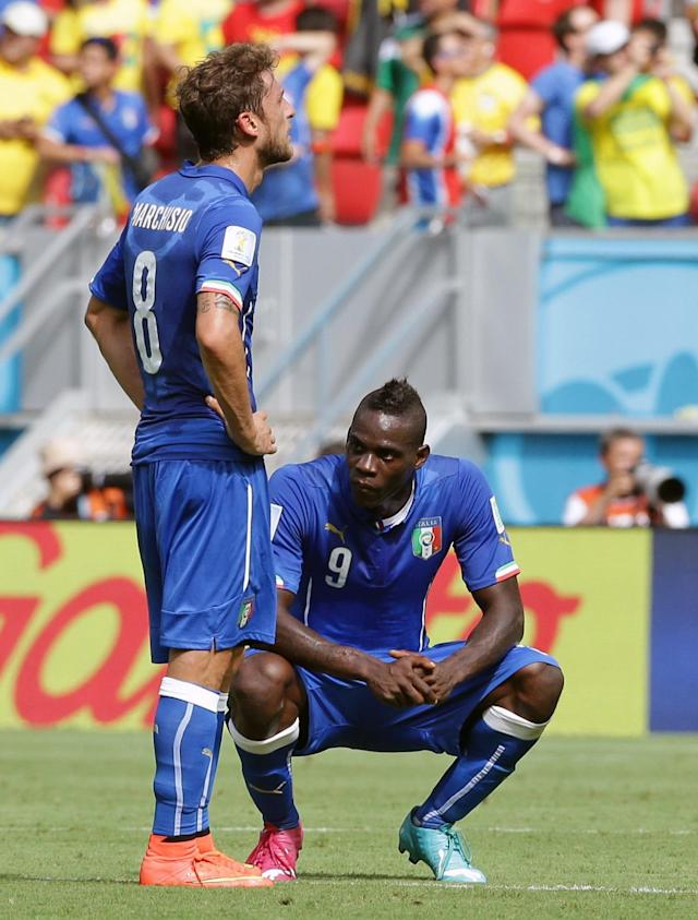 Italy's Mario Balotelli, right, and Italy's Claudio Marchisio react after Costa Rica's Bryan Ruiz scored the opening goal during the group D World Cup soccer match between Italy and Costa Rica at the Arena Pernambuco in Recife, Brazil, Friday, June 20, 2014. (AP Photo/Antonio Calanni)