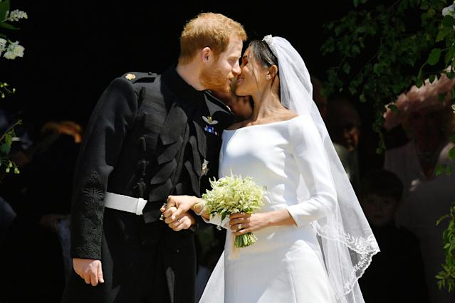 <p>Prince Harry and Meghan Markle kiss on the steps of St George's Chapel after their wedding ceremony. (Photo: Ben Birchall – WPA Pool/Getty Images) </p>