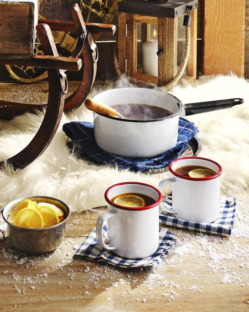 """<p>This spin on a hot toddy uses apple cider for a sweet taste. </p><p><strong><a href=""""https://www.countryliving.com/food-drinks/a30417282/warm-tea-cider-punch-recipe/"""" rel=""""nofollow noopener"""" target=""""_blank"""" data-ylk=""""slk:Get the recipe"""" class=""""link rapid-noclick-resp"""">Get the recipe</a>.</strong> </p>"""