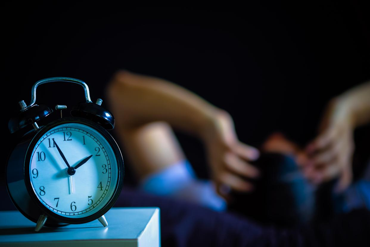 A man in bed suffering insomnia and sleep disorder. (Photo: Getty Images)