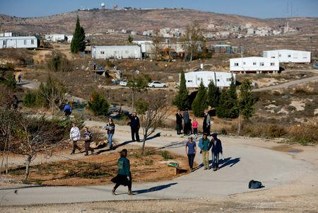 FILE PHOTO: Israelis prepare for an expected eviction of the Jewish settlement outpost of Amona in the West Bank, December 9, 2016 REUTERS/Amir Cohen/File Photo