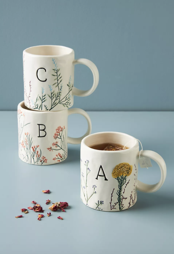 """<p><strong>Anthropologie</strong></p><p>anthropologie.com</p><p><strong>$14.00</strong></p><p><a href=""""https://go.redirectingat.com?id=74968X1596630&url=https%3A%2F%2Fwww.anthropologie.com%2Fshop%2Fdagny-monogram-mug&sref=https%3A%2F%2Fwww.prevention.com%2Flife%2Fg37518421%2Fcheap-christmas-gifts%2F"""" rel=""""nofollow noopener"""" target=""""_blank"""" data-ylk=""""slk:Shop Now"""" class=""""link rapid-noclick-resp"""">Shop Now</a></p><p>Whether they prefer sipping on coffee or tea in the mornings, everything will taste better in a cozy monogram mug. And this pick also features unique hand-painted floral designs on the outside for a fun gift.</p>"""