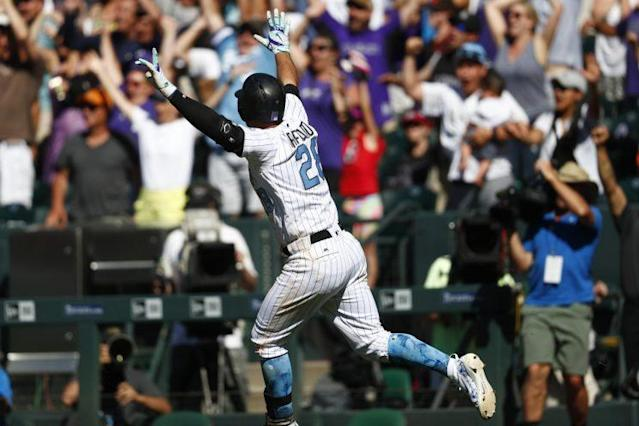 Nolan Arenado deserved to celebrate after Sunday's performance. (AP Photo)
