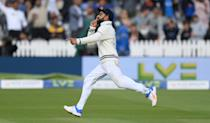 <p>LONDON, ENGLAND - AUGUST 16: India captain Virat Kohli celebrates by putting his finger to his lips after England batsman Sam Curran is caught behind by Pant during day five of the second Test Match between England and India at Lord's Cricket Ground on August 16, 2021 in London, England. (Photo by Stu Forster/Getty Images)</p>