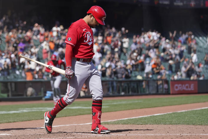 Cincinnati Reds' Eugenio Suarez walks away from the plate after striking out against the San Francisco Giants for the final out of the ninth inning of a baseball game in San Francisco, Wednesday, April 14, 2021. (AP Photo/Jeff Chiu)