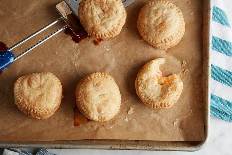 """These quick and easy hand pies are a cross between the beloved caramel apple and flaky apple turnover. You can take them with you on a fall park picnic. <a href=""""https://www.epicurious.com/recipes/food/views/3-ingredient-caramel-apple-hand-pies?mbid=synd_yahoo_rss"""" rel=""""nofollow noopener"""" target=""""_blank"""" data-ylk=""""slk:See recipe."""" class=""""link rapid-noclick-resp"""">See recipe.</a>"""