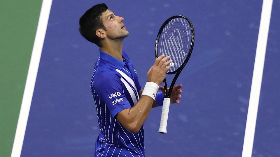 Novak Djokovic is pictured celebrating after his first round US Open victory.