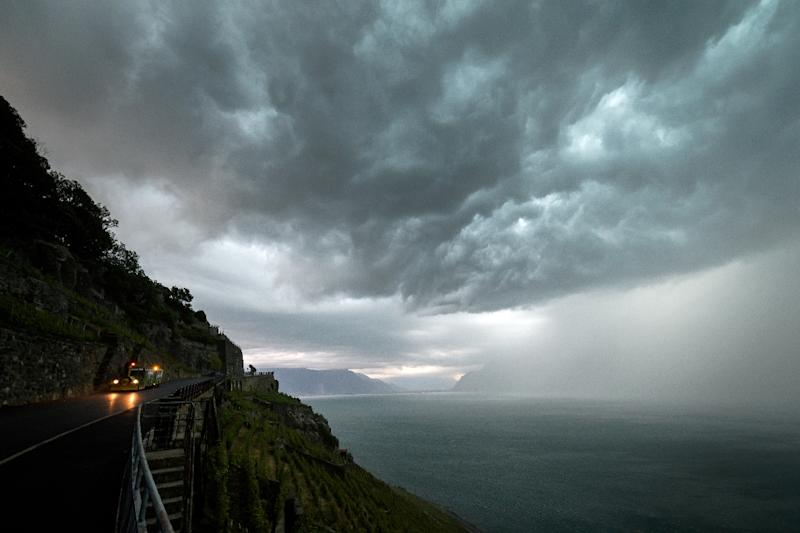 The storm brought winds reaching up to 110 kilometres (70 miles) per hour in western Switzerland (AFP Photo/FABRICE COFFRINI)